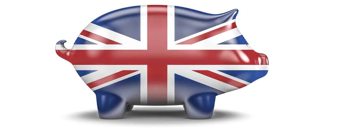 UK piggy bank / 3D render of piggy bank with British flag