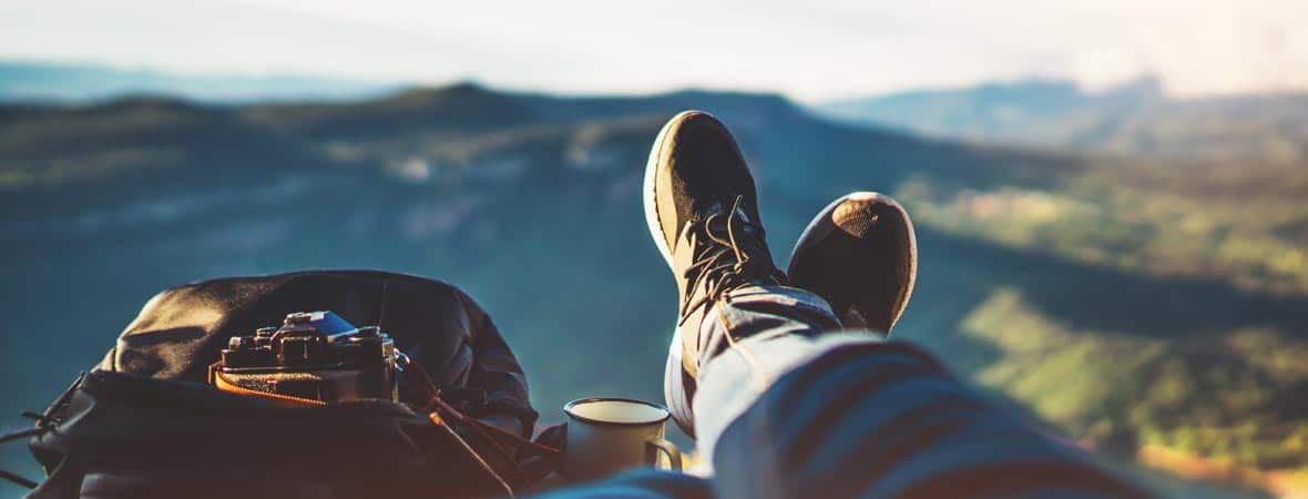 view trekking feet tourist backpack photo camera in auto on background panoramic landscape mountain, vacation concept, foot photograph hiking relax in auto, photographer enjoy trip holiday, mockup